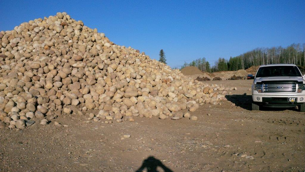 rock pile next to truck